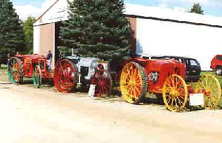 2 Massey No. 2 tractors and Parrett tractor in middle