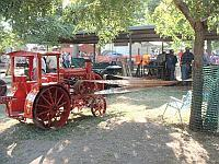 Model tractors provide power to the wood shelter.
